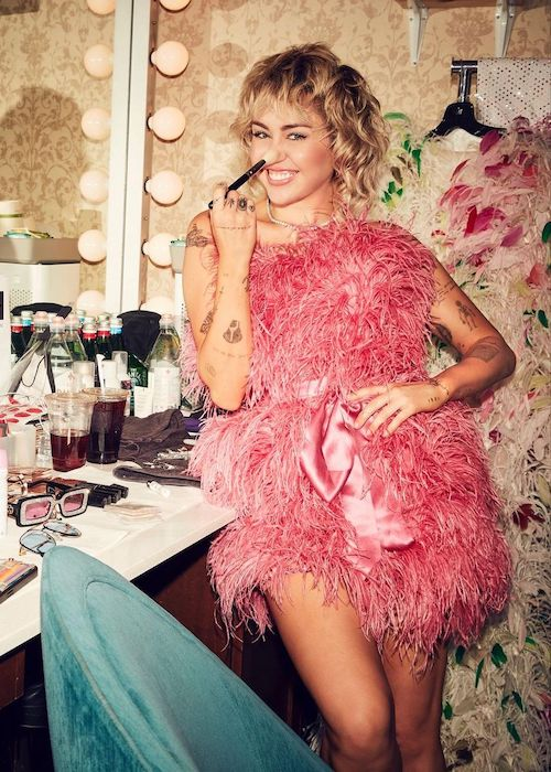 Miley Cyrus doing her makeup in June 2021