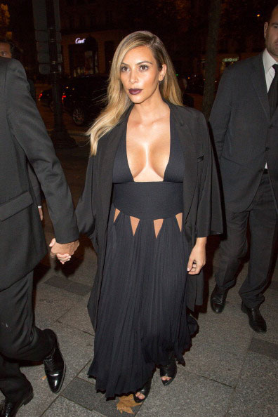 Kim Kardashian in black outfit during Givenchy Spring 2014