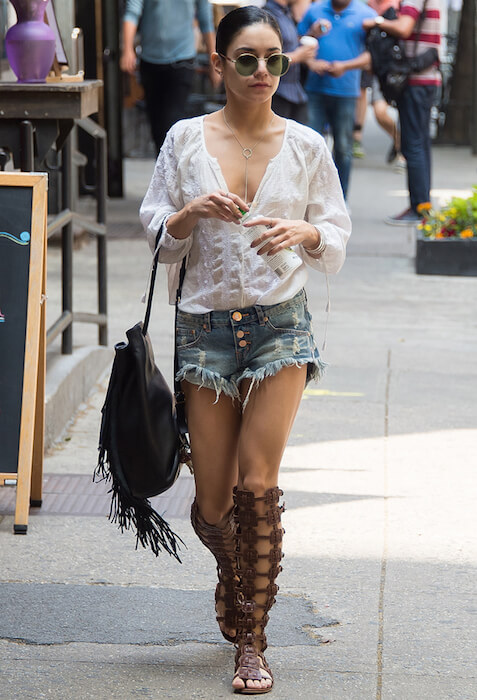Vanessa Hudgens roaming in New York on May 31, 2015 wearing gladiator sandals and denim shorts