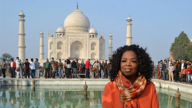 Oprah Winfrey in front of Taj Mahal during her visit to India in 2012