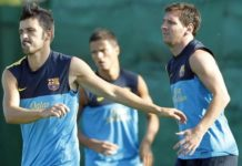 David Villa and Lionel Messi warming up before the training session