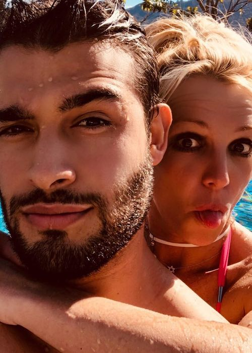 Sam Asghari and Britney Spears in a selfie while swimming in July 2018