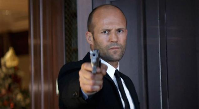 Jason Statham pointing gun