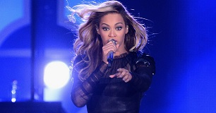 Beyonce Knowles at singing show. See her workout and diet.