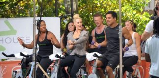 Peta Murgatroyd and Mario Lopez doing workout on the set of Extra