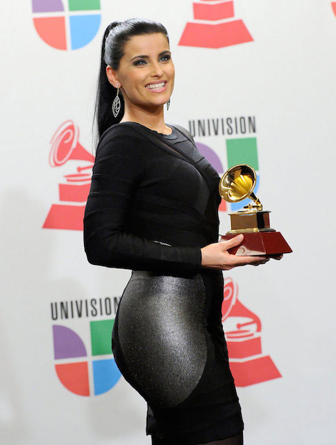 Nelly Furtado with a Grammy Award