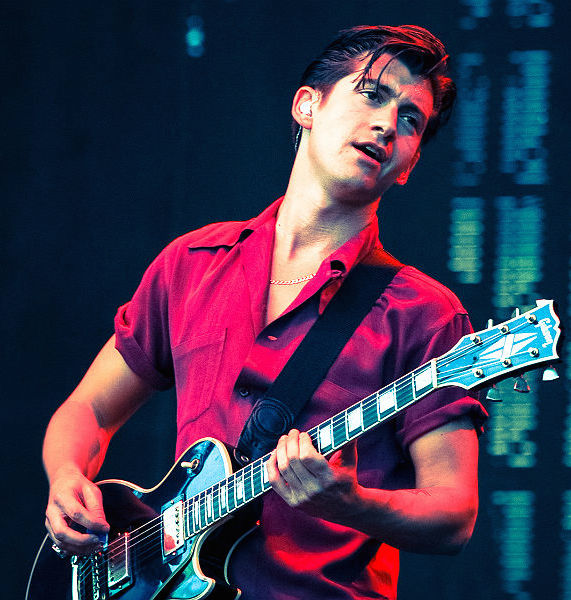 Alex Turner playing guitar
