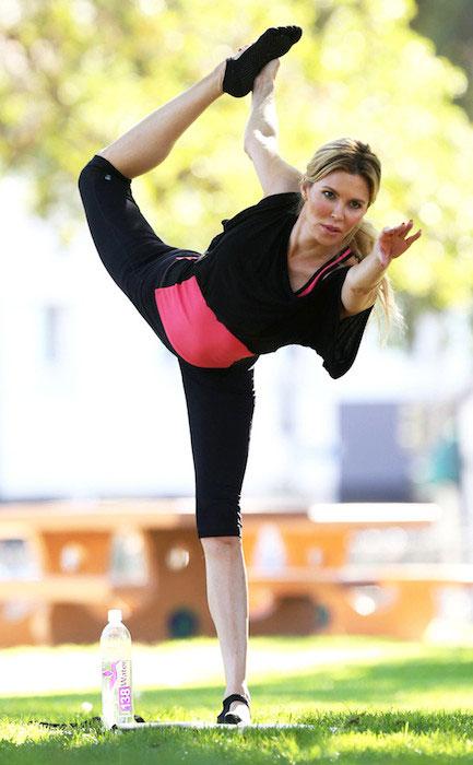 Brandi Glanville doing yoga in the garden