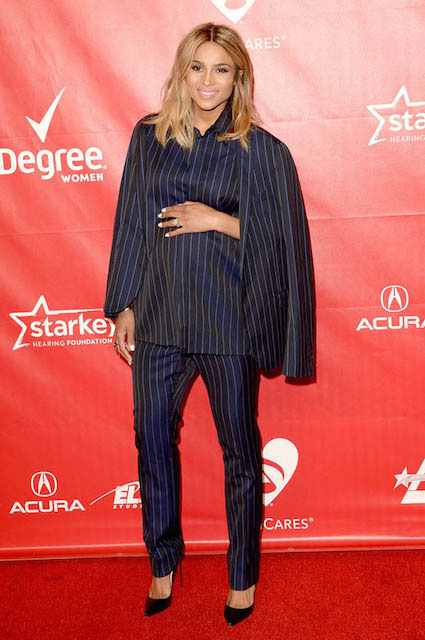 Ciara at 2014 MusiCares Person Of The Year Gala wearing Lanvin Fall 2014 Menswear Navy Blue Pinstripe Suit.