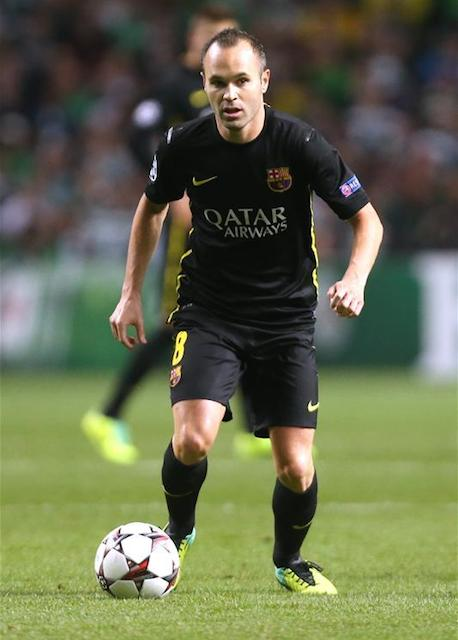 Andres Iniesta dribbling the ball