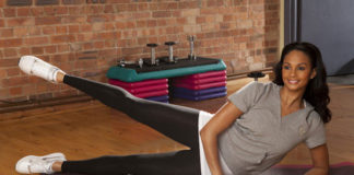 Alesha Dixon working out on mat