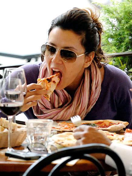 Eva Longoria eating pizza on her cheat day.