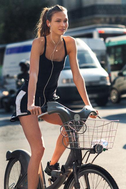 Karlie Kloss cycling