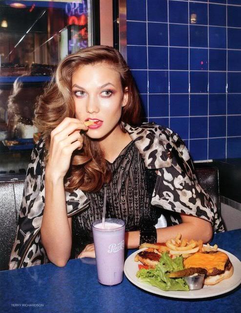 Karlie Kloss eating her meal