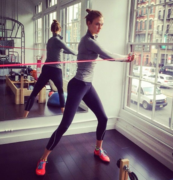 Karlie Kloss during a gym exercise