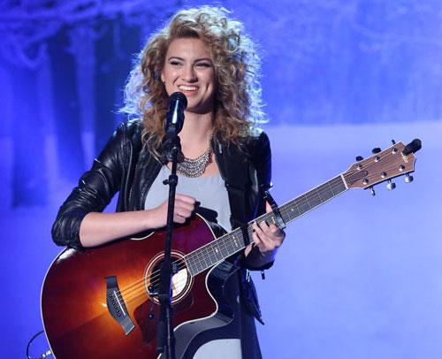 Tori Kelly playing guitar
