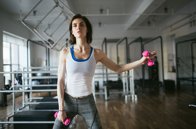Hilary Rhoda working out with dumbbells