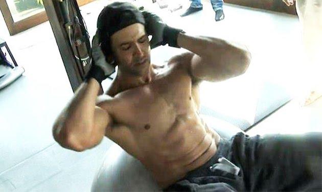 Hrithik Roshan doing crunches.