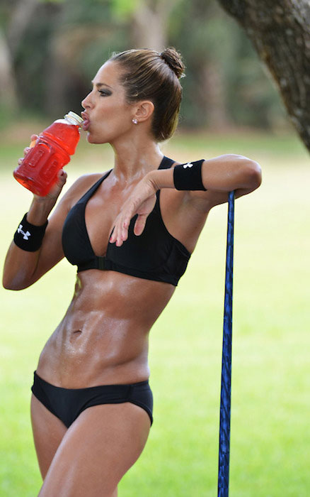 Jennifer Nicole Lee hydrating her body after workout session