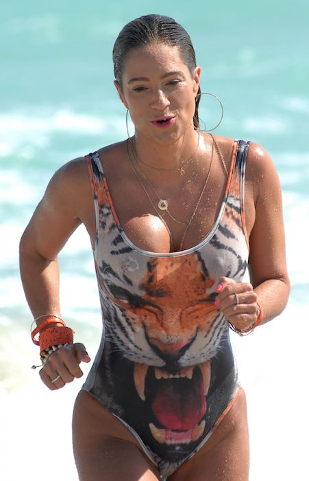 Jennifer Nicole Lee in swimsuit on Miami Beach in January 2014.