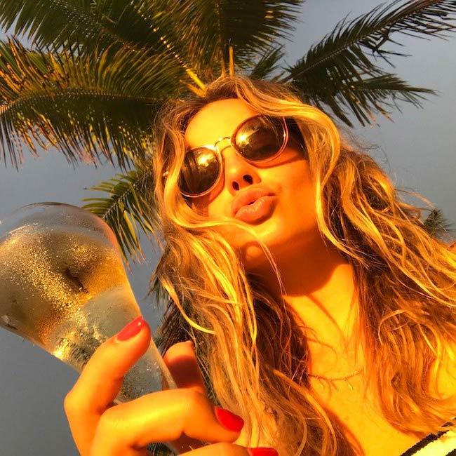 Margot Robbie enjoying a drink in March 2017