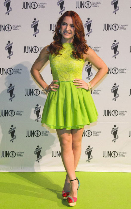 Victoria Duffield poses for a photo on the green carpet at the 2013 Juno Gala.