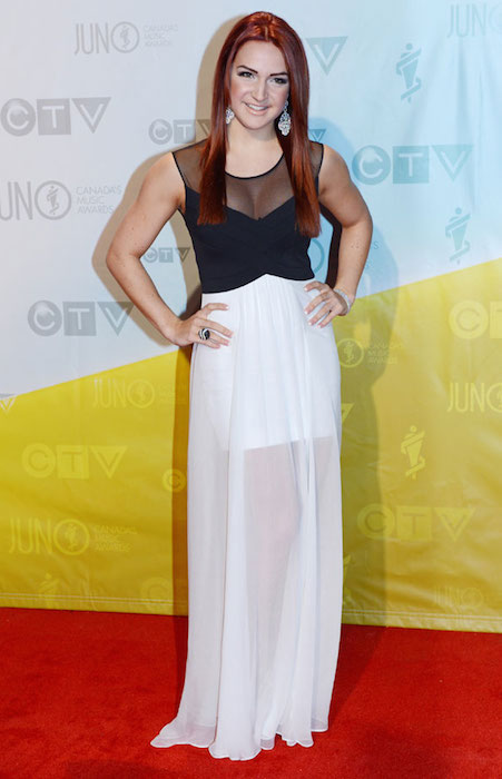 Victoria Duffield poses for photographs on the red carpet during the 2013 Juno Awards in Regina