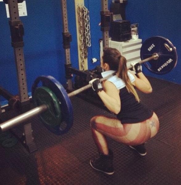 Alice Matos doing squats.
