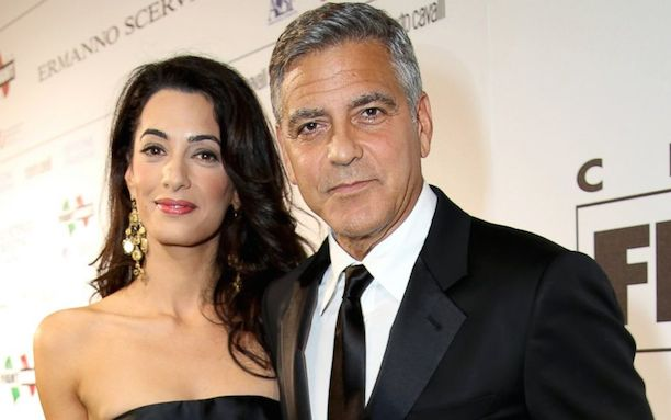 Amal Alamuddin and George Clooney attend the Celebrity Fight Night gala celebrating Celebrity Fight Night In Italy.