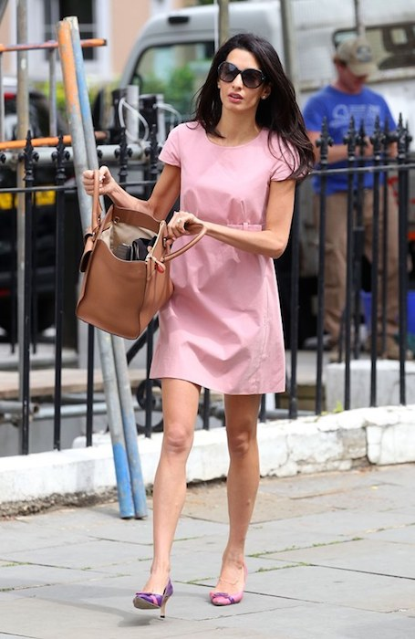 Amal Alamuddin out in London in pink after lunch with friends.