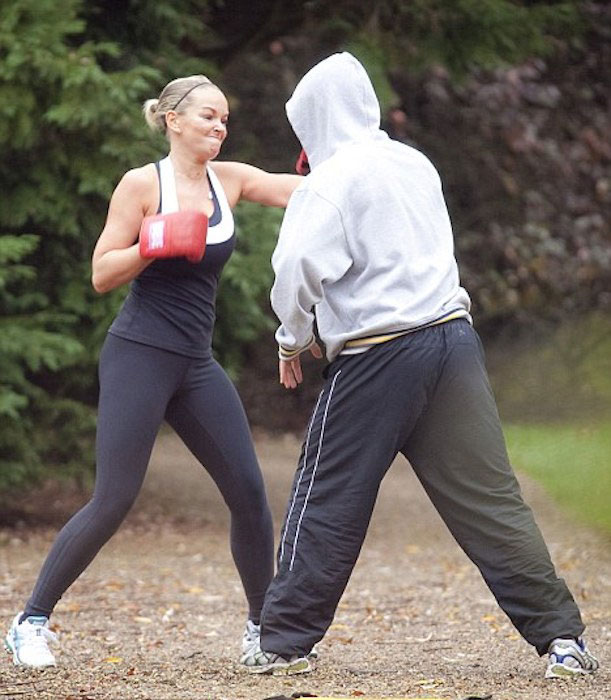 Jennifer Ellison boxing with her trainer.