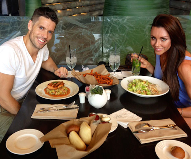 Michelle Heaton and Hugh Hanley eating at a eatery.