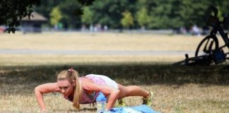 Michelle Heaton doing push-ups.