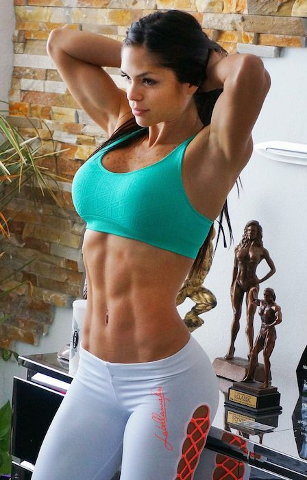 Michelle Lewin showing her abs and arms.