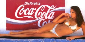 Stacey Williams in front of Coca Cola advertisement