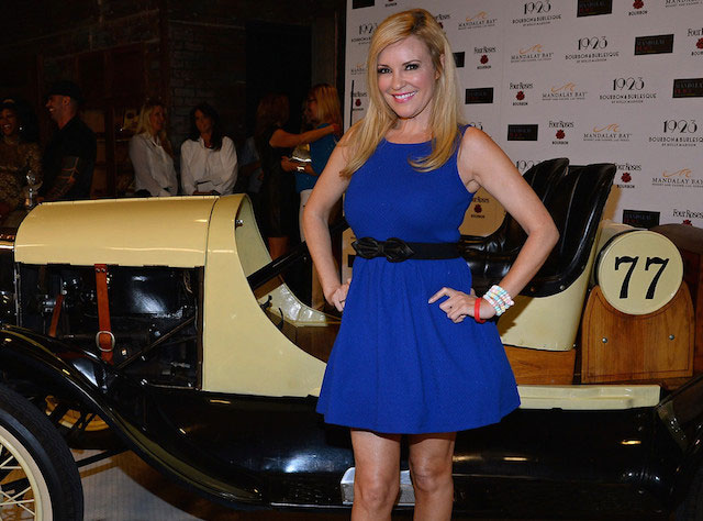 Bridget Marquardt poses in front of a 1923 Ford Model T racing car as she attends the grand opening of 1923 Bourbon & Burlesque by Holly Madison at the Mandalay Bay Resort and Casino on May 1, 2014.