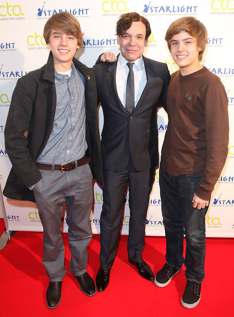 Cole Sprouse and Dylan Sprouse pose for a photo with George Caceres before teaching a Master Workshop on acting, hosted by Celebrity Talent Academy and Starlight Children's Foundation.