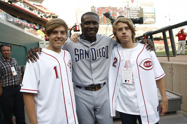 Dylan Sprouse and Cole Sprouse pose for a picture with Orlando Hudson #1 of the San Diego Padres before the game between the Cincinnati Reds and the San Diego Padres on August 12, 2011.