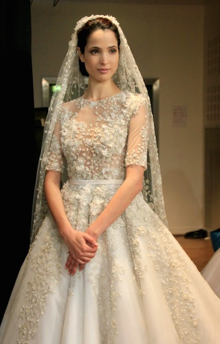 Hanaa Ben Abdesslem wearing Ralph and Russo wedding gown backstage at Haute Couture Fall 2014-15.