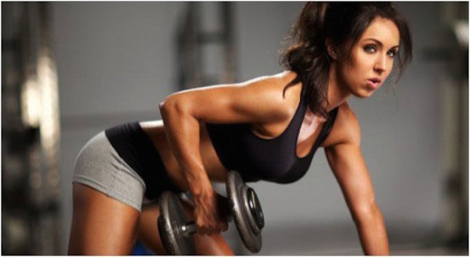 Hot woman lifting weights.