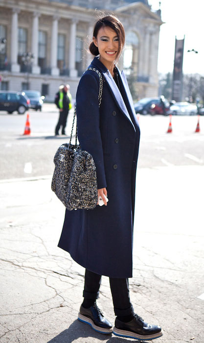 Shu Pei Qin wearing Chanel bag and Prada shoes during Paris Fashion Week.