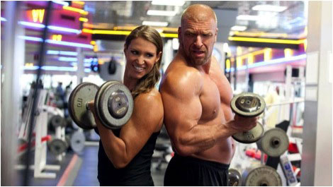 Triple H working out with female partner