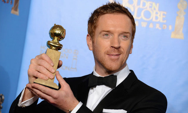 """Damian Lewis poses with the Golden Globe 2013 Award for """"Best Performance by an Actor in a Television Series."""""""