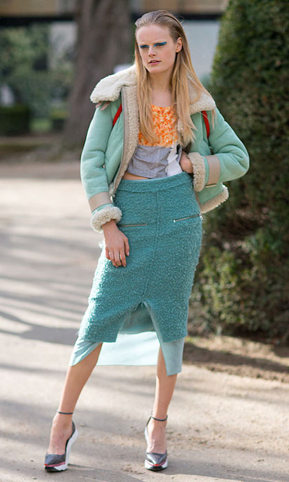 Hanne Gaby Odiele street style wearing mint coloured jacket, orange and grey top, mint coloured, knee length boucle skirt, wedged heels during Paris Fashion Week.