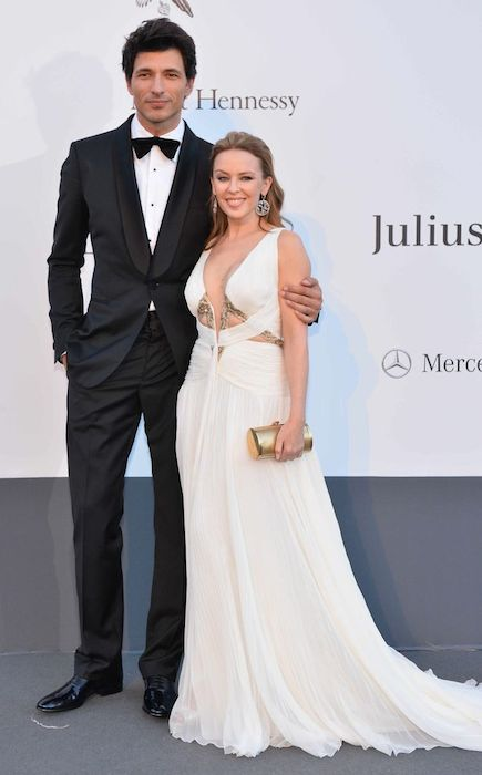 Kylie Minogue and Andres Velencoso in Roberto Cavalli at the amfAR Gala 2013 in Cannes.