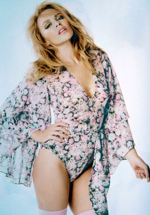 Kylie Minogue posing for the official calendar 2015.