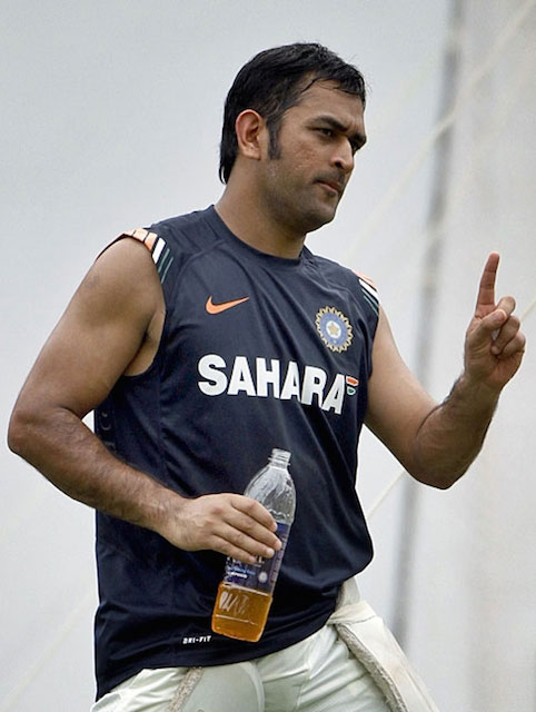 MS Dhoni re-energizing with a drink.