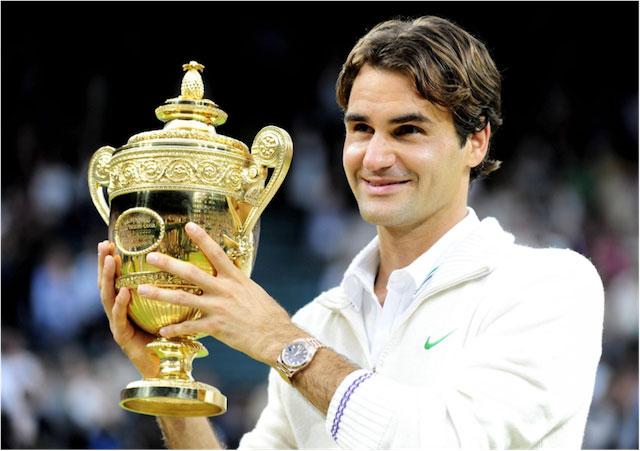 Roger Federer with a trophy.