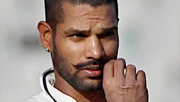 Shikhar Dhawan twirling his mustache.