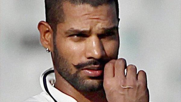 Shikhar Dhawan twirling his mustache.